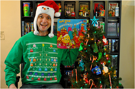 An ugly Christmas sweater featuring Pac-Man, a Christmas tree, and an absurd amount of ghosts!