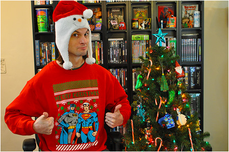 An ugly Christmas sweater featuring Superman and Batman trying to look serious!