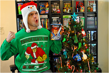 An ugly Christmas sweater featuring Lion-O from the ThunderCats dressed as Santa!