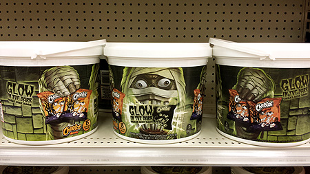 Egads! It's a Halloween pail filled with glow-in-the-dark bags of Cheetos, and it's all being attacked by a mummy!