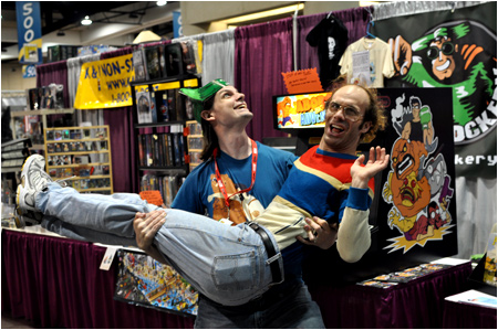Rog holds Keith Apicary in his mighty arms at the I-Mockery booth during the 2010 San Diego Comic-Con. Destined for love... and adventure!