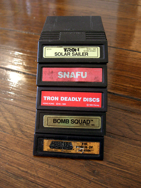 A pile of Intellivision games! Tron: Solar Sailer, SNAFU, Tron: Deadly Discs, Bomb Squad, Masters of the Universe: The Power of He-Man!