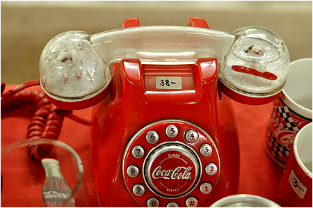 A Coke / Coca-Cola telephone with snowglobes in the handle!?